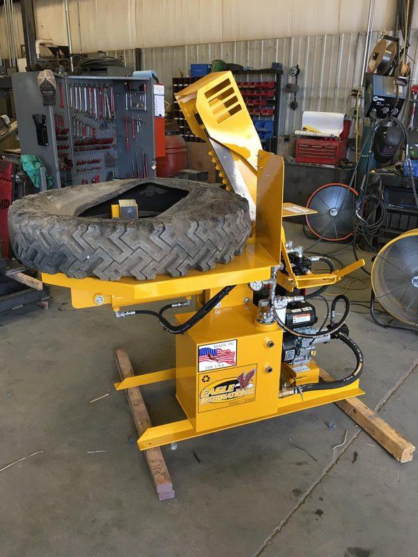 TC gator tire shear cutting a car tire.