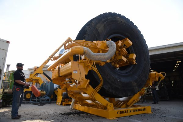Eagle Edge 360 pealing the tread from an OTR tire into rubber mulch.